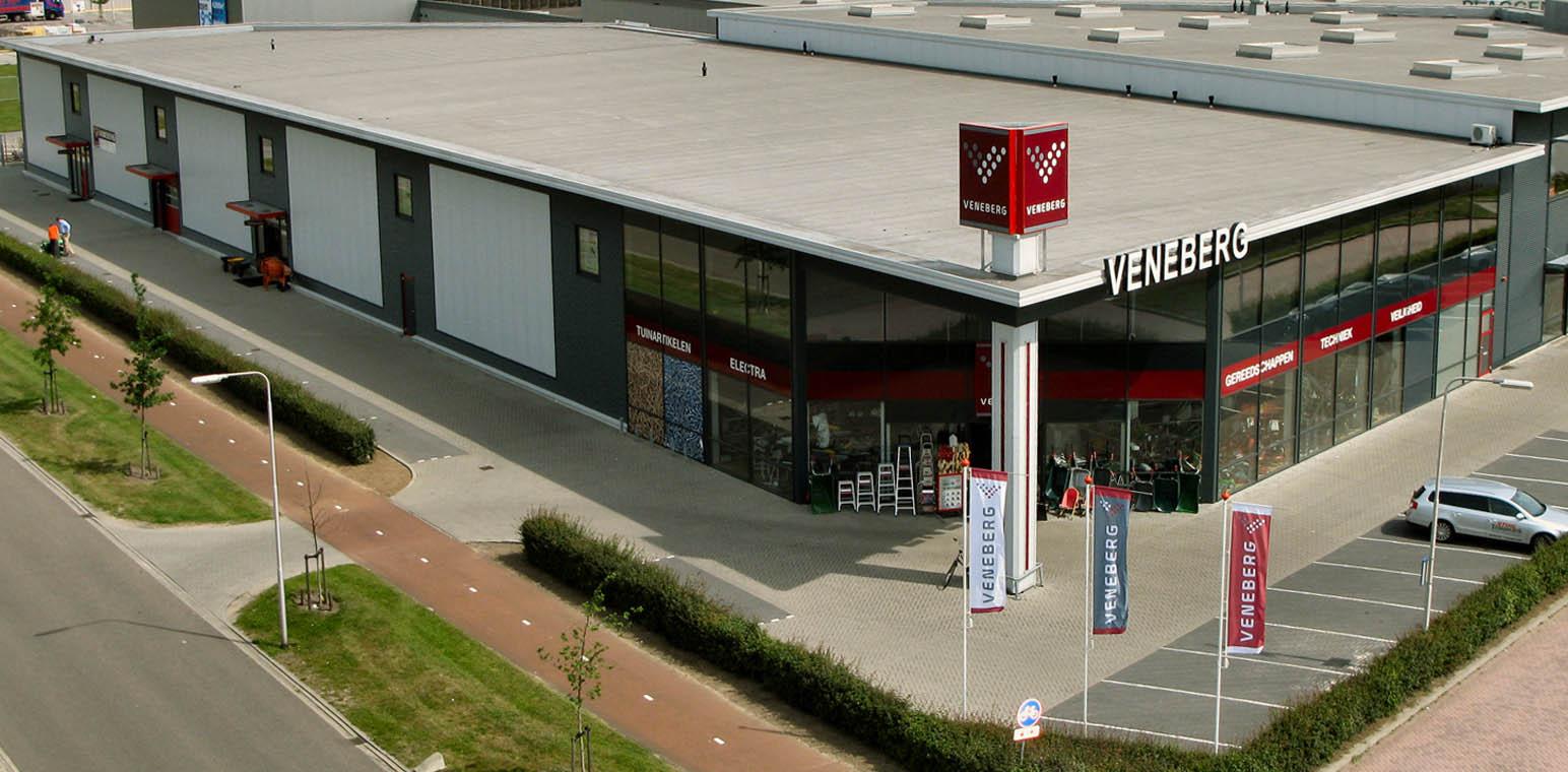 Slide 1: foto van de winkel